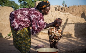 Hawa washes her one-year-old son Roukiatou at home, Nabitenga, Burkina Faso.